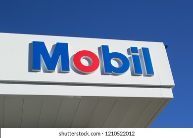 Truro, Canada - October 23, 2018: Mobil gas station sign. Mobil is an American based oil company having merged with Exxon in 1999 forming it's parent company, ExxonMobil.