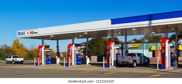 Truro, Canada - October 23, 2018: Mobil gas station. Mobil is an American based oil company having merged with Exxon in 1999 forming it's parent company, ExxonMobil.