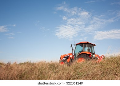 TRURO, CANADA - SEPTEMBER 29, 2015: Kubota tractor in field. Kubota Corporation is a Japanese heavy equipment manufacturer with an array of products such as tractors and agricultural equipment.