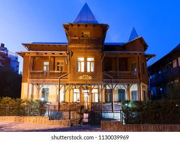 TRUSKAVEC, UKRAINE - 06 JUNE 2018: Illuminated facade of vintage hotel. Truskavec town, Ukraine.
