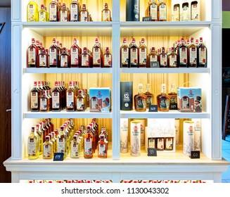 TRUSKAVEC, UKRAINE - 10 JUNE 2018: Interior of the Cheese house. Wide variety of different liquors on the shelves. Truskavec, Ukraine.