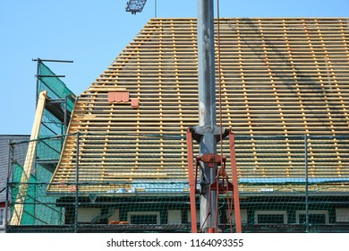 Truss of a protected historical Building new tiled Roof with Beaver Tail Tiles