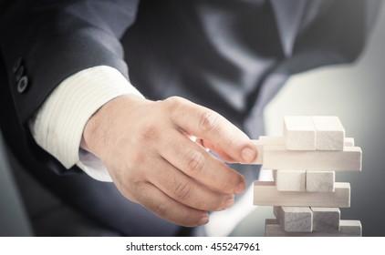 Trust concept: Business man decision choosing the wood block