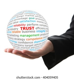 Trust concept. Hand take white ball with trust word in red color.