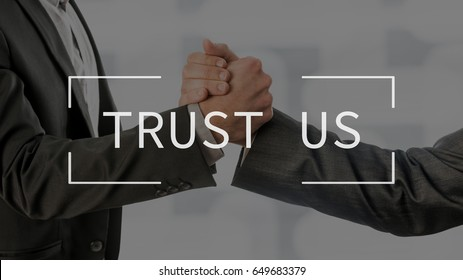 Trust us text over conceptual business scene with two partners gripping their hands.
