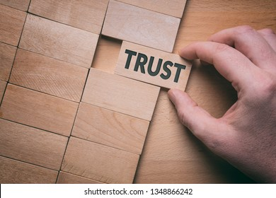Trust word written on wooden block. Building trust business concept.