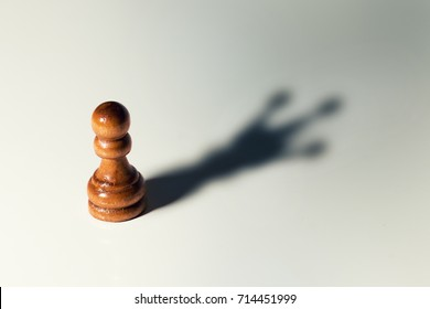 trust yourself, self confident concept - chess pawn with king shadow