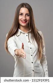 Trustworthy latino businesswoman offering a handshake