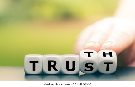 "Truth instead of trust. Hand turns dice and changes the word ""Trust"" to ""Truth""."