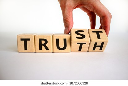 Truth or trust symbol. Male hand turns wooden cubes and changes the word 'Truth' to 'Trust'. Beautiful white background. Business and truth or trust concept, copy space.