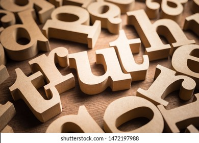 Truth word found in the scattered wood alphabets on the table