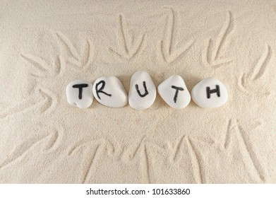 Truth word on group of stones on the sand