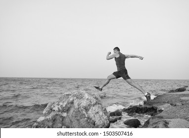The truth is you can always run harder. Sometimes the truth hurts. Running man on beach. Runner training outdoors. Fit male sport fitness exercising. Running sport and hobby. Workout great result.