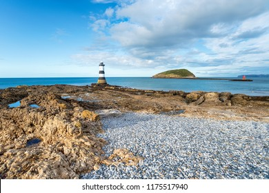 The Trwyn Du Lighthouse at Penmon Point on Anglesey with Puffin Island in the background