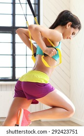 TRX. Beautiful girl in the gym