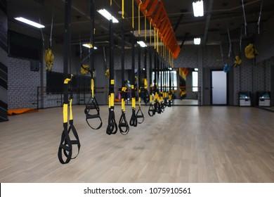 TRX straps in modern gym