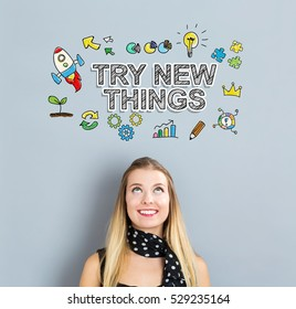 Try New Things concept with happy young woman on a gray background