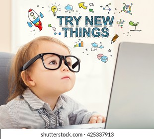 Try New Things concept with toddler girl using her laptop