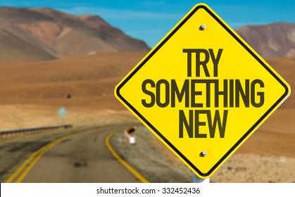 Try Something New sign on desert road