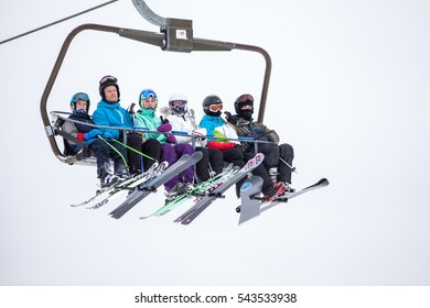 TRYSIL, NORWAY, FEBRUARY 2015, people taking the ski lift up the mountain on a cold and overcast winter day.