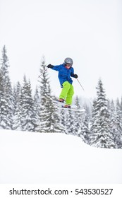 TRYSIL, NORWAY, FEBRUARY 2015, person doing down hill skiing, jumping into the air on a cold, winter day on the mountain slopes.