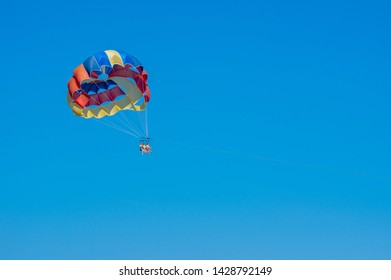 Tsambika beach, Rhodes, Greece - 5. 12.2019. Three unidentified young ladies parasailing and taking selfies for social media. Flying high having fun. Recreation outdoors and shooting