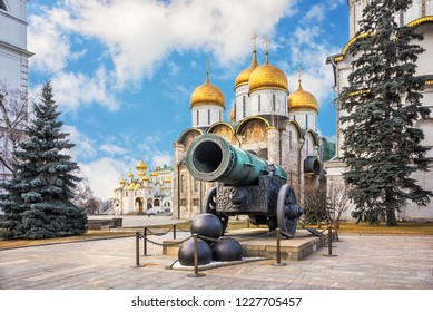 Tsar Cannon in the Moscow Kremlin, the Assumption Cathedral and the Cathedral of the Annunciation under the blue sky