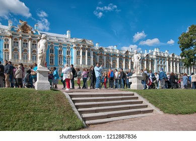 TSARSKOYE SELO, SAINT-PETERSBURG, RUSSIA – AUGUST 22, 2018: Many people stay in line to enter to The Catherine Palace in The State Museum Preseve Tsarskoye Selo