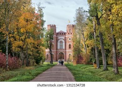 TSARSKOYE SELO, SAINT-PETERSBURG, RUSSIA – OCTOBER 8, 2018: People on the alley near The Arsenal Pavilion in The Alexander Park. The Tsarskoye Selo is the State Museum Preserve