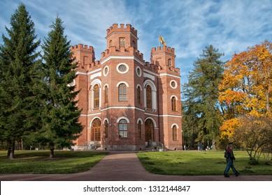 TSARSKOYE SELO, SAINT-PETERSBURG, RUSSIA – OCTOBER 8, 2018: People near The Arsenal Pavilion in The Alexander Park. The Tsarskoye Selo is the State Museum Preserve