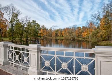 TSARSKOYE SELO, SAINT-PETERSBURG, RUSSIA – OCTOBER 8, 2018: The Large Lamsky Bridge near The Lamsky Pond in landscape area of Alexander Park