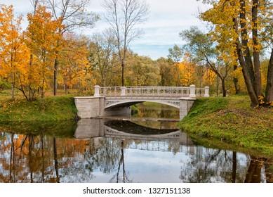 TSARSKOYE SELO, SAINT-PETERSBURG, RUSSIA – OCTOBER 8, 2018: Third Lamsky Bridge near Lamsky Pond in the landscape area of Alexander Park