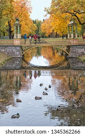 TSARSKOYE SELO, SAINT-PETERSBURG, RUSSIA – OCTOBER 8, 2018: People on the one of The Small Chinese Bridges over The Krestovy Canal in Alexander Park