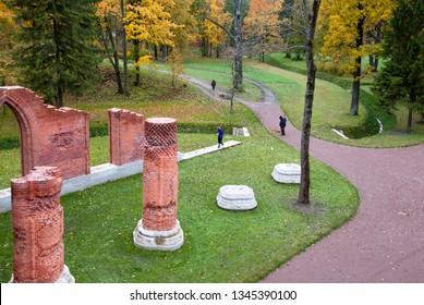 TSARSKOYE SELO, SAINT-PETERSBURG, RUSSIA – OCTOBER 8, 2018: People take pictures near The Chapelle Pavilion in Alexander Park in The Stae Museum Preserve Tsarskoye Selo