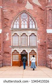 TSARSKOYE SELO, SAINT-PETERSBURG, RUSSIA – OCTOBER 8, 2018: People near the door of The Chapelle Pavilion in Alexander Park in The State Museum Preserve Tsarskoye Selo