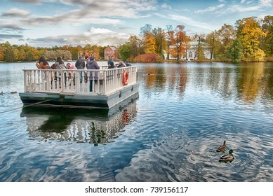 TSARSKOYE SELO, SAINT-PETERSBURG, RUSSIA - OCTOBER 7, 2017: People on the ferry on the Great Pond. The historical Ferry line connects the Catherine Park  with the Hall on the Island