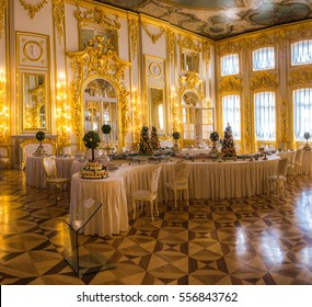 TSARSKOYE SELO, ST. PETERSBURG, RUSSIA - AUGUST 22, 2015: Big dinner table inside the Catherine palace.