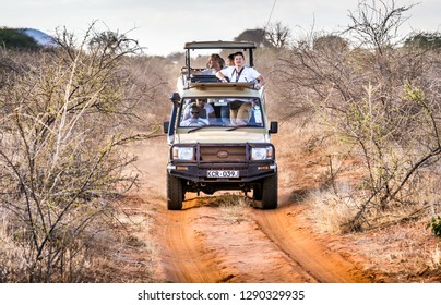 TSAVO EAST RESERVE, KENYA - OCTOBER 11, 2018: Safari cars with unindentified tourists on adventure trip in Tsavo East National Park, Kenya