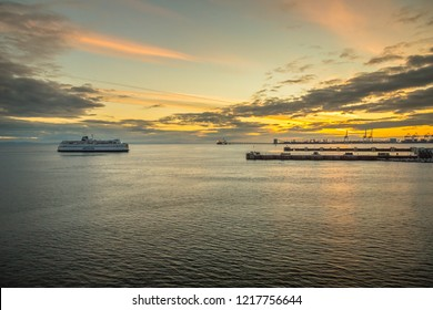 TSAWWASSEN JUNE, 2018: A BC Ferry entering the Tsawwassen Ferry Terminal with Railway Terminal behind taken at sunset time