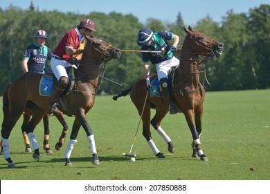 TSELEEVO, MOSCOW REGION, RUSSIA - JULY 26, 2014: Match Tseleevo Polo Club - Oxbridge Polo Team during the British Polo Day. Oxbridge won 5-4