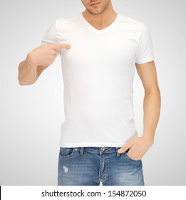 t-shirt design concept - man in blank white t-shirt