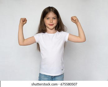 t-shirt design concept - smiling little girl in blank white t-shirt ,happy little strong girl raising hands, white background
