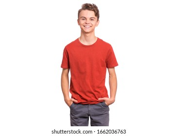 T-shirt design concept. Teen boy in blank red t-shirt, isolated on white background. Mock up template for print. Happy child with hands in pockets, looking at camera, front view.