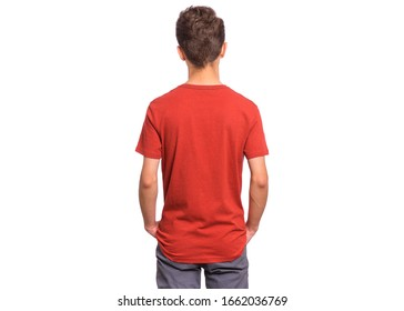 T-shirt design concept. Teen boy in blank red T-shirt, isolated on white background - back view. Mock up template for print. Child with hands in pockets - rear view.
