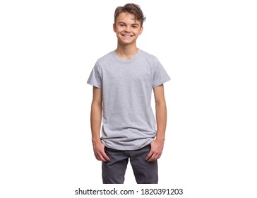 T-shirt design concept. Teen boy in blank gray t-shirt, isolated on white background.