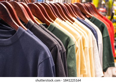T-Shirt of man for sales on hangers at super market  Thailand
