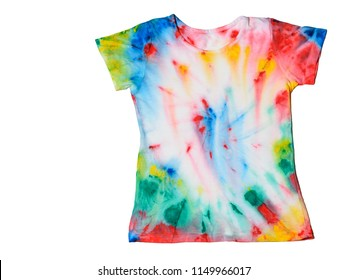 T-shirt painted in tie dye style isolated on a white background. FLat lay. The view from the top. Place for text.