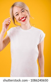 T-shirt template. Smiling young woman on yellow background