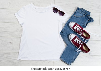 T-shirt top view, t shirt mock up, empty tshirt. Summer concept casual clothes background copy space. Blank shirt on wooden background