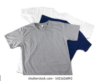 T-shirts di cut on white background. Heather grey and navy blue and white color. With clipping path at t-shirts shape and shadow for retouching.